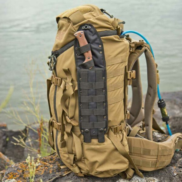 Survival Kukri inside nylon sheath attached to pack MOLLE webbing.