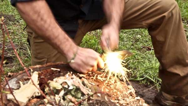 Jeff Zausch demonstrating the Skeletek Bushcraft ferro rod striking method